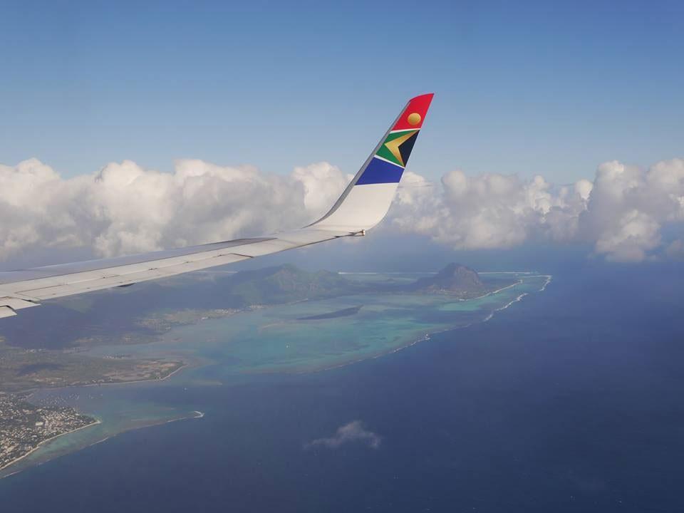 SAA_Flugzeug_Tragfläche_Wolken_KPRN